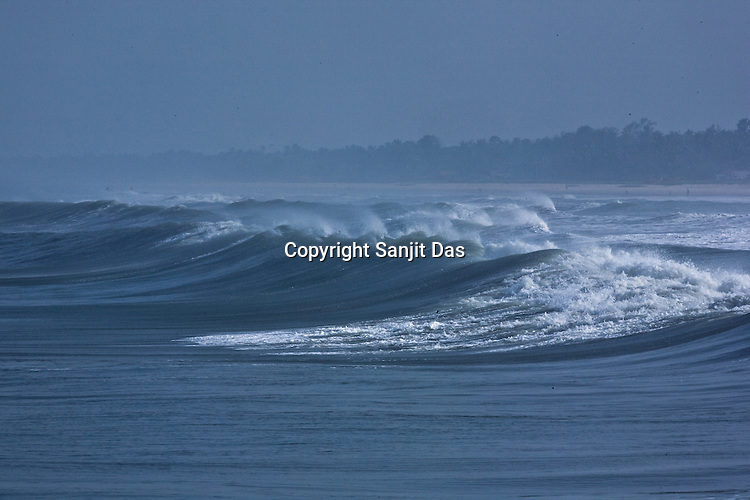 """The waves as seen on the Arabian Sea on the beach front of Mangalore, Karnataka, India.  ..Krishna devotees in the Gaudiya Vaishnava tradition of Hinduism, they are known collectively as the """"surfing swamis."""" The """"surfing ashram"""" is growing in popularity and surfing here is a form of meditation, a spiritual practice leading to heightened states of awareness."""