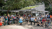 Crowds of burger lovers eat lunch at the Shake Shack in Madison Square Park in New York on Saturday, August 16, 2014.  The Union Square Hospitality Group, owner of the Shake Shack, is reported to be preparing for an initial public offering. The rapidly expanding chain is estimated to have earnings of $20 million next year. (© Richard B. Levine)