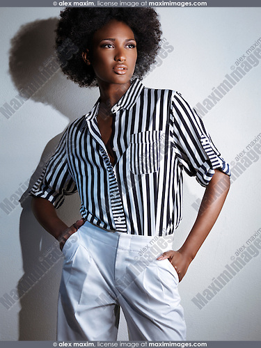 Stock photo: Beautiful young african american black woman wearing ...