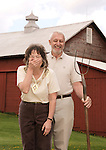 Photos Copyright Jim Mendenhall 2011 May 7, 2011 Craig and Carol Powell at their rural home in Meadville, Pa. for World Vision via Genesis Photos. This set up became a parody of American Gothic the famed painting.