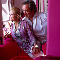 Designer-artists Liza Bruce and Nicholas Alvis Vega sitting in their fucshia pink living room