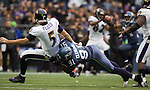 Baltimore Ravens quarterback Joe Flacco is hit Seattle Seahwks  defensive end Chris Clemons after passing against the  at CenturyLink Field in Seattle, Washington on November 13, 2011. The Seahawks beat the Ravens 22-17.  ©2011 Jim Bryant Photo. All Rights Reserved.