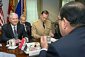 Arlington, VA - July 23, 2009 - United States Secretary of Defense Robert M. Gates (left) hosts a Pentagon meeting on Thursday, July 23, 2009, with visiting Prime Minister Nouri al-Maliki of Iraq (right foreground).  A broad range of issues were expected to be discussed as Iraqi security forces assume the primary role of security providers.  Among those joining Gates for the talks is Chairman of the Joint Chiefs of Staff Navy Admral Mike Mullen (center). .Mandatory Credit: Robert D. Ward - DoD via CNP
