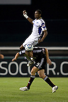 Danny Allsopp (9) of D.C. United gets a head on the ball as Pablo Escobar (6) of the Kansas City Wizards goes over his back at RFK Stadium in Washington, DC.  D.C. United defeated the Kansas City Wizards, 2-1.