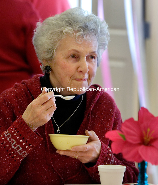WOODBURY CT. 10 February 2014-021014SV05-Connie Baldwin of Woodbury enjoys ice cream during the Sweetheart Ice Cream Social at the senior center in Woodbury Monday. The seniors enjoyed the ice cream to the sounds of the cello played by Thirzah Bendokas of Naugatuck.<br /> Steven Valenti Republican-American
