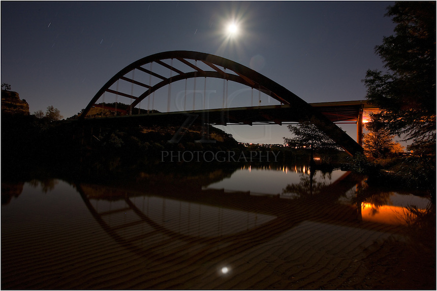 This image was a long exposure - nearly 6 minutes - allowing the moonlight to saturate the Pennybacker Bridge and waters below. Taken outside Austin, Texas.