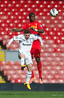 LIVERPOOL, ENGLAND - Easter Monday, April 1, 2013: Liverpool's Stephen Sama in action against Tottenham Hotspur's Jack Munns during the Under 21 FA Premier League match at Anfield. (Pic by David Rawcliffe/Propaganda)