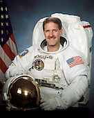 Houston, TX - (FILE) (October 2000) --- Official portrait of Astronaut John M. Grunsfeld, mission specialist, STS-125, taken in October, 2000.  Grunsfeld is scheduled to launch Monday, May 11, 2009 at 2:01 p.m. EDT aboard the Space Shuttle Atlantis for a mission to service the Hubble Space Telescope..Credit: NASA via CNP
