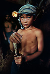An 11-year-old boy stands outside a gold mine where he works in Mindanao, Philippines, 1985.<br />