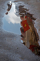 Reflection in a pool of water with the Vietnamese Flag and general and interesting street scenes in Ho Chi Minh City.<br />