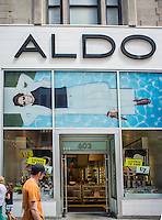 Shoppers pass an Aldo shoe store on Fifth Avenue in New York on Friday, June 28, 2013. (© Richard B. Levine)