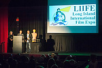 Bellmore, New York, USA. July 16, 2015. L-R, Actress MARILYN CHRIS presents to filmmakers JORDAN HOROWITZ and FRANK FERENDO the Best Documentary Award for ANGEL OF NANJING during the LIIFE Awards Ceremony, at Bellmore Movies. The film is about Chen Si who has saved over 300 people from commiting suicide at the Yangtze River Bridge in Nanjing, the most popular place in the world to commit suicide. It was the 18th Annual Long Island International Film Expo.