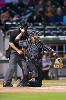 Charlotte Knights catcher Kevan Smith (32) throws the ball back to his pitcher during the game against the Norfolk Tides at BB&T BallPark on May 2, 2017 in Charlotte, North Carolina.  The Knights defeated the Tides 8-3.  (Brian Westerholt/Four Seam Images)
