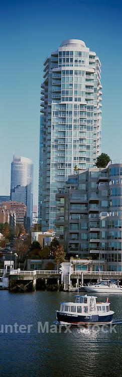 Vancouver, BC, British Columbia, Canada - Aquabus Ferry crossing False Creek past High Rise Apartment Condominium Building in Yaletown - Panoramic View