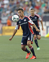 New England Revolution midfielder Diego Fagundez (14) controls the ball. In a Major League Soccer (MLS) match, the New England Revolution (blue) tied D.C. United (white), 0-0, at Gillette Stadium on June 8, 2013.