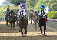 May 19, 2012 I'll Have Another (left), Martin Gutierrez up, wins the Preakness Stakes at Pimlico Race Course in Baltimore, Maryland. Bodemeister (right), Mike Smith up, is second.  photo by Joan Fairman Kanes