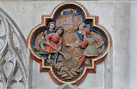St John's disciples bury his body, plaque on the North side of the Gothic choir screen, 1490-1530, commissioned by canon Adrien de Henencourt and made by the sculptor Antoine Ancquier, depicting the life of St John the Baptist, at the Basilique Cathedrale Notre-Dame d'Amiens or Cathedral Basilica of Our Lady of Amiens, built 1220-70 in Gothic style, Amiens, Picardy, France. Amiens Cathedral was listed as a UNESCO World Heritage Site in 1981. Picture by Manuel Cohen