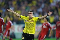 Fussball Bundesliga Saison 2011/2012 1. Spieltag Borussia Dortmund - Hamburger SV V.l.: Kevin GROSSKREUTZ (BVB) jubelt nach seinem Tor zum 1:0.