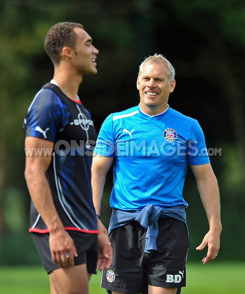 First team coach Brad Davis shares a joke with Olly Woodburn. Bath Rugby training session on August 21, 2012 at Farleigh House in Bath, England. Photo by: Patrick Khachfe/Onside Images