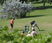 Kailua, Hawaii - December 24, 2008 -- United States President-elect Barack Obama (right) with long-time friend Dr. Eric Whitaker (left) hits golf balls on the driving range at Mid-Pacific Country Club in Kailua, Hawaii on Wednesday, Dec. 24, 2008..Credit: Joaquin Siopack / Pool via CNP