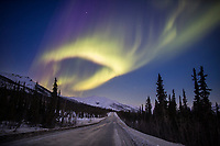The Aurora borealis over the James Dalton Highway in the Brooks Range of Alaska.