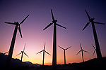 Silhouetted Windmill farm in the desert sunset light with windmills near Palm Springs California USA.