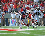 Ole Miss running back Jeff Scott (3) vs. Auburn defensive back Demetruce McNeal (12) at Vaught-Hemingway Stadium in Oxford, Miss. on Saturday, October 13, 2012.