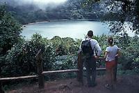 Young couple looking at Laguna Botos in the Parque Nacional Volcan Poas, Costa Rica