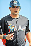 13 March 2012: Miami Marlins outfielder Kyle Jensen returns to the dugout during a Spring Training game against the Atlanta Braves at Roger Dean Stadium in Jupiter, Florida. The two teams battled to a 2-2 tie playing 10 innings of Grapefruit League action. Mandatory Credit: Ed Wolfstein Photo