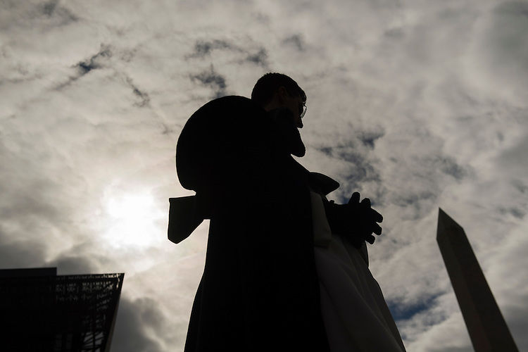 UNITED STATES - JANUARY 27: Fr. Athanasius Murphy stands near the National Museum of African American History and Culture during the speaking program of the annual March for Life, January 27, 2017. Attendees march from the monument to Capitol Hill to oppose abortion. (Photo By Tom Williams/CQ Roll Call)