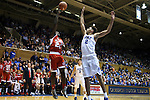 30 October 2015: Florida Southern's R.J. June (24) shoots over Duke's Chase Jeter (2). The Duke University Blue Devils hosted the Florida Southern College Moccasins at Cameron Indoor Stadium in Durham, North Carolina in a 2015-16 NCAA Men's Basketball Exhibition game. Duke won the game 112-68.