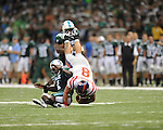 Ole Miss quarterback Jeremiah Masoli (8) scrambles and is tackled by Tulane safety Shakiel Smith (4)  at the Louisiana Superdome in New Orleans, La. on Saturday, September 11, 2010. The play was called back because of penalty. Ole Miss won 27-13.