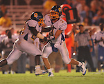 Oxford High's Parker Adamson (3) hands off to Oxford High's Mont Dean (22) vs. Lafayette High at William L. Buford Stadium in Oxford, Miss. on Friday, September 2, 2011. Lafayette won 40-12