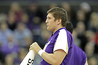 DEC 22, 2015:  Washington cheerleader Jake Volk entertained fans during a TV timeout in the game against Seattle University. Washington defeated Seattle University 79-68 at Alaska Airlines Arena in Seattle, WA.