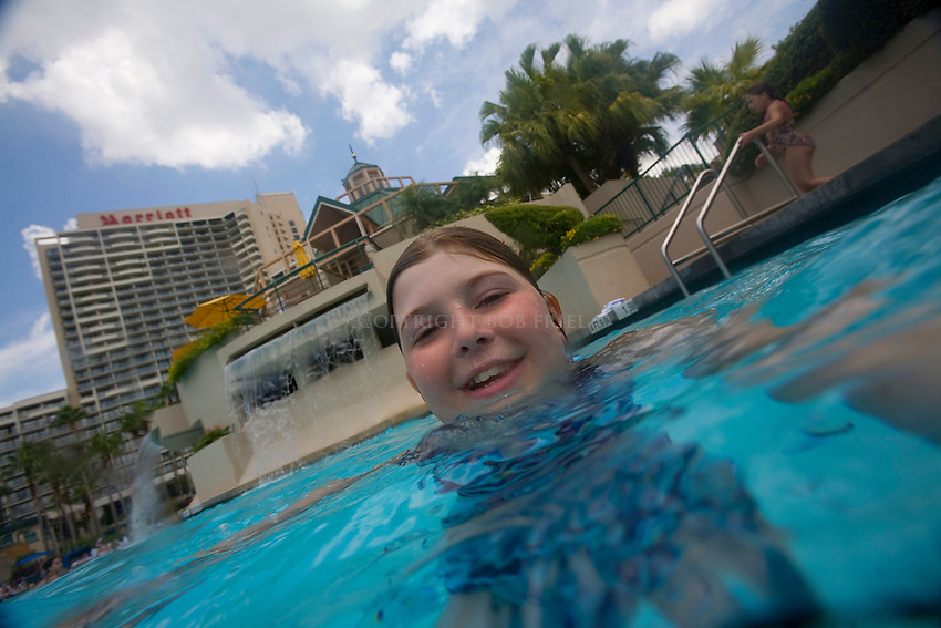 Kids having fun at the Marriott World Center hotel pool in Orlando, Florida