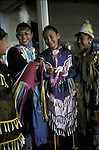 Navajo Native American teenagers dressed in regalia @ pow wow in Chinle AZ an example of ethnic pride
