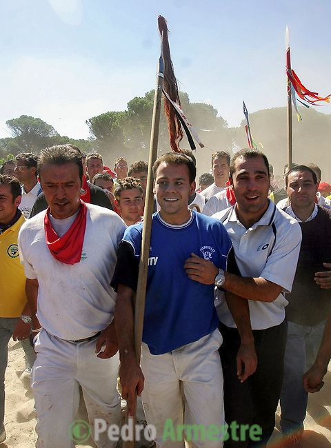 The man who made the fatal strike to kill  the bull walks back to Tordesillas after the 'El toro de la Vega' (The bull of the plain) bullfight, 13 September 2005 in Tordesillas. On the second Tuesday of September, since the fifteenth century the village has celebrated this very special bullfight. The arena of the bullfight is the plain across the river from the village and it is up to a number of young men with lances to dispute the honour of making the fatal strike. (c) Pedro ARMESTRE