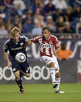 Chivas USA midfielder Gerson Mayen (14) breaks for the net as New England Revolution defender Seth Sinovic (27) defends. Chivas USA defeated the New England Revolution, 4-0, at Gillette Stadium on May 5, 2010.