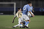 12 December 2008: Sam Cronin (2) of Wake Forest tackles the ball from Zach Loyd (3) of North Carolina.  The Wake Forest University Demon Deacons were defeated by the University of North Carolina Tar Heels 0-1 at Pizza Hut Park in Frisco, TX in an NCAA Division I Men's College Cup semifinal game.
