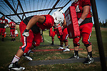 FRESNO, CA - AUGUST 11, 2014:   Fresno State's defensive line works out during morning practice. CREDIT: Max Whittaker for The New York Times