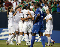 Kenny Cooper (17, center) is congratulated by his teammates after scoring the United States' second goal while Osman Chavez (2) looks on.  The US Men's National Team defeated Honduras 2-0 in the semifinals of the Gold Cup at Soldier Field in Chicago, IL on July 23, 2009.