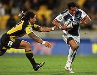Blues second five Isaia Toeava tries to beat Ma'a Nonu during the Super 14 rugby union match between the Hurricanes and Blues at Westpac Stadium, Wellington, New Zealand on Friday 1 May 2009. Photo: Dave Lintott / lintottphoto.co.nz