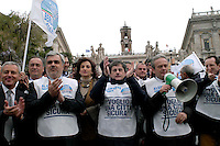 "Rome   April 4  2008.Demonstration for the security Of the People Of the Liberties' in Capitol.The mayor of Rome Gianni Alemanno with Mauro Cutrufo and Alfredo Antoniozzi .The bib is written ""I want a sure city"""