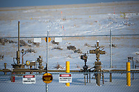 """Oil pipeline infrastructure pops out of the plains near Douglas, Wyo., Thursday, November 22, 2013. The state will require pre-drilling testing of groundwater at sites where hydraulic fracturing, also known as """"fracking"""" is used. (Kevin Moloney for the New York Times)"""