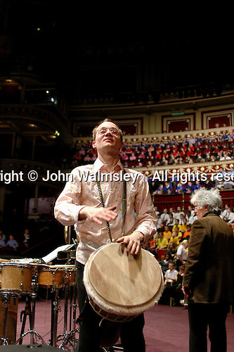 Buckinghamshire Schools Concert rehearsal at the Royal Albert Hall, London, with percussion group, Three Strange Angels.  Richard Benjafield playing the djembe drum which dates back to 12th century West Africa.