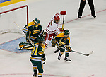 ST CHARLES, MO - MARCH 19:  Shea Tiley (35) of the Clarkson Golden Knights makes a save as Annie Pankowski (19) of the Wisconsin Badgers tries to tip the puck during the Division I Women's Ice Hockey Championship held at The Family Arena on March 19, 2017 in St Charles, Missouri. Clarkson defeated Wisconsin 3-0 to win the national championship. (Photo by Mark Buckner/NCAA Photos via Getty Images)