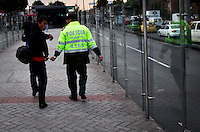 A police escorts a thieve inside of an station of the public and massive transportation known as Transmilenio are seen on their road in Bogota, Colombia. 1/03/2012.  Photo by Eduardo Munoz Alvarez / VIEWpress.