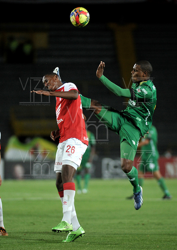 BOGOTA - COLOMBIA -24 -09-2014: Yerry Mina (Izq.) jugador de Independiente Santa Fe disputa el balón con Jose Moreno (Der.) jugador de La Equidad durante partido entre Independiente Santa Fe y La Equidad por la fecha11 de la Liga Postobon II-2014, en el estadio Nemesio Camacho El Campin de la ciudad de Bogota. / Yerry Mina (L) jugador of Independiente Santa Fe struggles for the ball with Jose Moreno R)  player of de La Equidad during a match between Independiente Santa Fe and La Equidad for the date 11 of the Liga Postobon II -2014 at the Nemesio Camacho El Campin Stadium in Bogota city, Photo: VizzorImage  / Luis Ramirez / Staff.