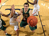 Nov. 12, 2010; Charlottesville, VA, USA;  William & Mary Tribe forward Kyle Gaillard (23) shoots the ball in front of Virginia Cavaliers guard Joe Harris (12) during the game at the John Paul Jones Arena. Virginia won 76-52.  Mandatory Credit: Andrew Shurtlef