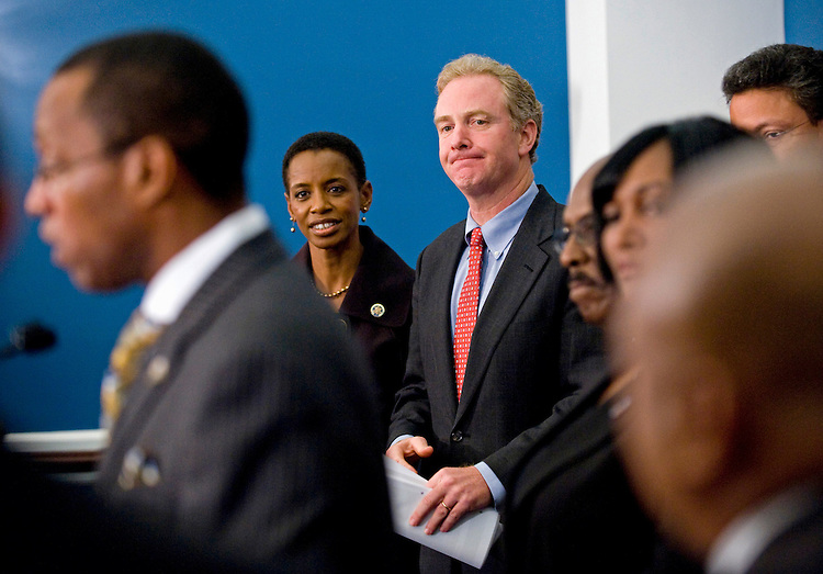 WASHINGTON, DC - Oct. 06: Rep. Donna Edwards, D-Md., and Rep. Chris Van Hollen, D-Md., during a news conference with Maryland Black Mayors Inc., urging quick action in Congress on a health care reform bill. MBM is a non-profit, private organization of Maryland mayors. (Photo by Scott J. Ferrell/Congressional Quarterly)